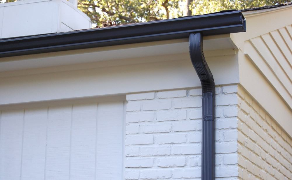 Do Garages Really Need Gutters? Prevent Heavy Damage!